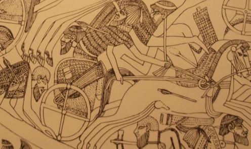 """חייל במרכבה, ממוצא שמי, בשריון קשקשים, נפגע בקרב נגד המלך המצרי תחותמס הרביעי: סוך המאה ה-15 לפסה""""נ. הרבה לפני הופעת היוונים (מתוך ספרו של ידין)"""
